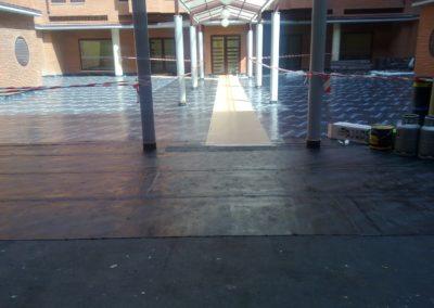 Rehabilitación de patio interior por reposición de la impermeabilización y del H. Impreso